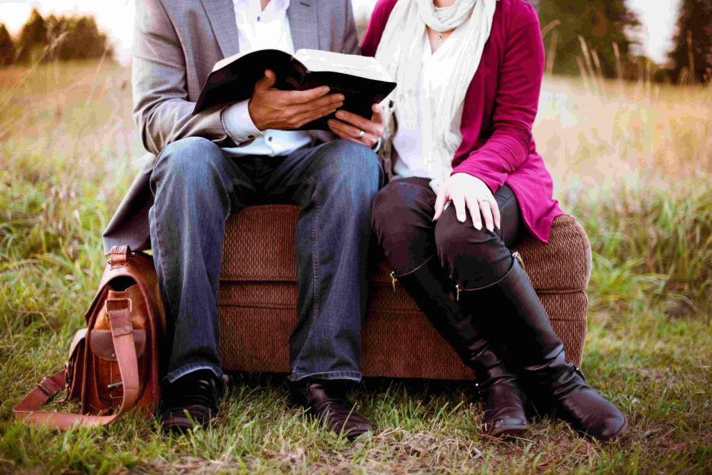 Couple Reading Bible verses on marriage